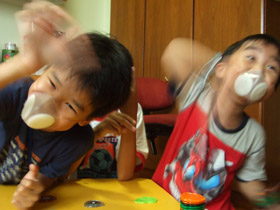 kids playing with Totobobo mask on