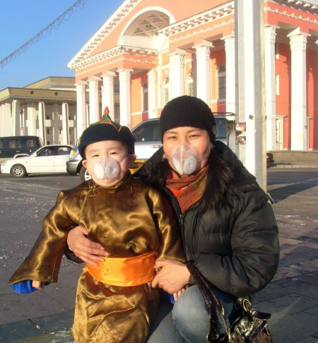 Mother and child from Mongolia wearing Totobobo mask